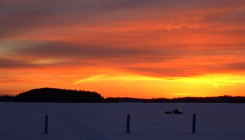 snowmobile at sunset